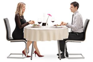 Young man and woman eating on a date